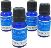 Aromatherapy essential oil blends, 100% pure blended oil, organic aromatherapy oil blends in blue glass bottles.